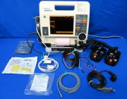 Medtronic Lifepak 12 Biphasic Defribrillator/Monitor w/ Hard Paddles, Hands Free Cable w/ Electrodes, 4-Lead Expandable