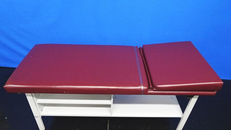 Winco 857 Burgandy Adjustable Back Treatment Table with Two Shelfs 72X28X30 Max Weight Capacity:400Lbs, 90 Days Warra